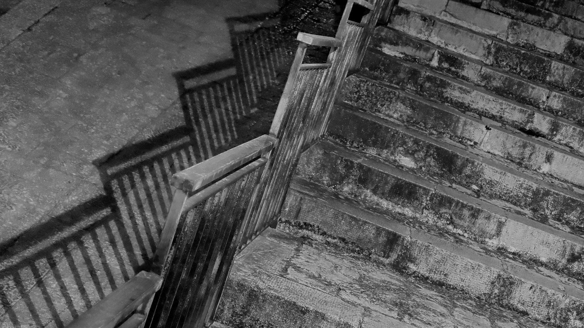 Black and white image of stairs.